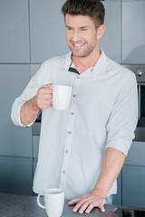 Handsome man enjoying a mug of fresh coffee