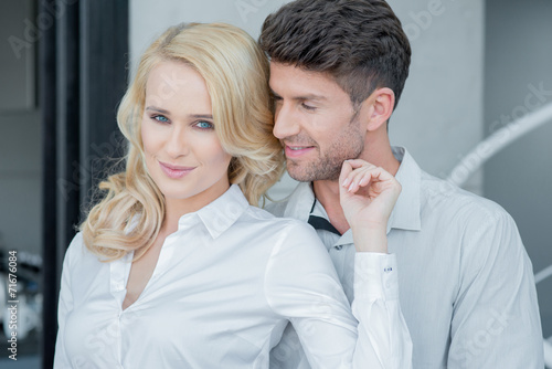 canvas print picture Lovers in White Long Sleeves Attire Fashion Shoot