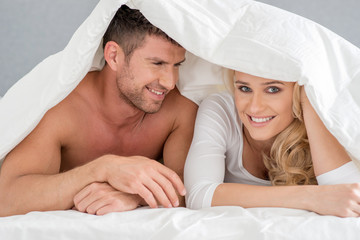Close up Middle Age Romantic Couple on Bed