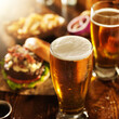 beer and burgers on wooden table - 71676878