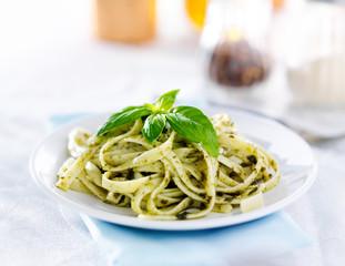 italian fettuccine in basil pesto sauce