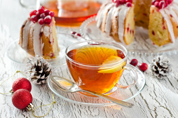 Cup of tea with lemon and cranberry cake for christmas