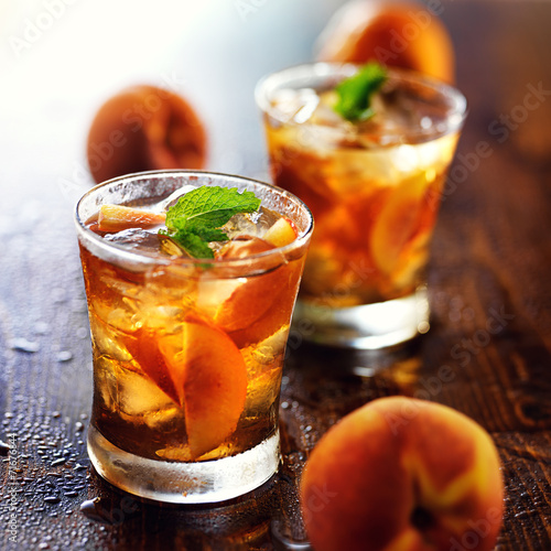 two glasses of sweet peach iced tea - 71676844