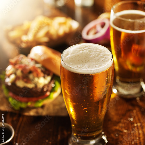 Keuken foto achterwand Bier / Cider beer and burgers on wooden table