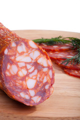 chorizo sausage with herbs and pepper on the board