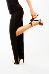 Woman silhouette with high heel shoe and black dress
