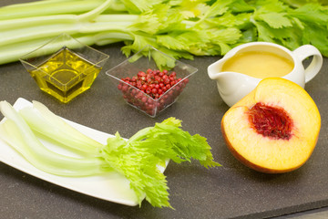 gourmet ingredients for recipe with celery and peach