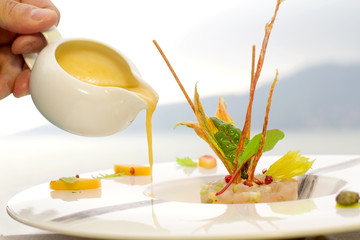 serving dish with lampuga tartare with celery and peach cream se