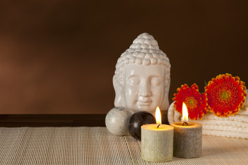 Spa still-life with buddha, flowers, candles
