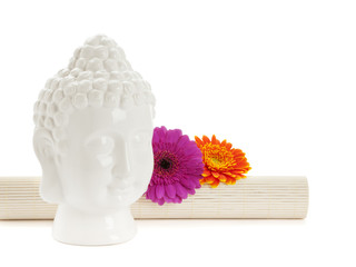 Buddha head and flowers isolated