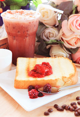 toast bread and sweet strawberry and berry jam in white dish bes