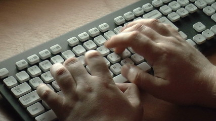 The video shows hands writing on keyboard, close-up shot