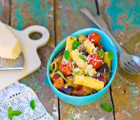 macaroni with vegetables, sausages and parmesan