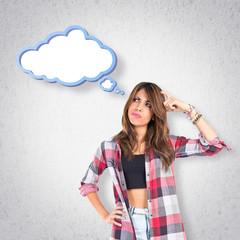 Girl thinking over grey background