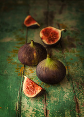 Fresh figs on green vintage wooden table