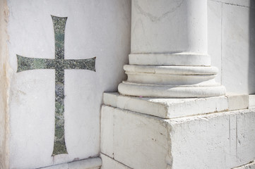 Christian cross inlayed in the marble