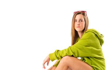 Blonde girl with skate over white background