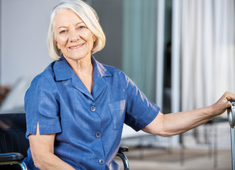 Happy Senior Woman Sitting On Wheelchair