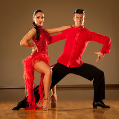latino dance couple in action - dancing wild samba