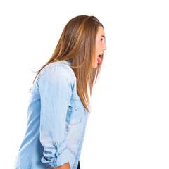 Girl doing a joke over isolated white background