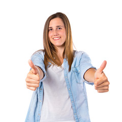 Girl with thumbs up over white background