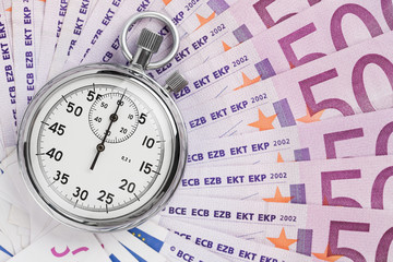 Time is money, analog stopwatch on the euro banknotes