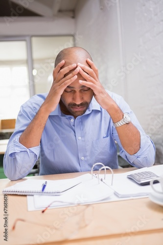 canvas print picture Tired businessman with paperwork at desk