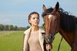 Obrazy na płótnie, fototapety, zdjęcia, fotoobrazy drukowane : An attractive young woman with a horse