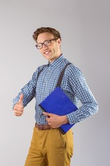 Geeky student holding a notebook