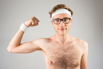Geeky shirtless hipster flexing bicep