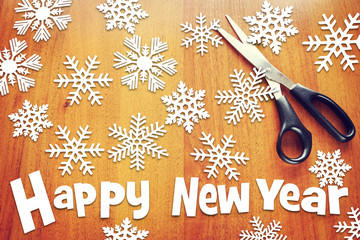 New Year background with various snowflakes on wooden surface
