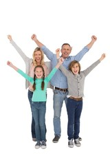 Smiling family raising their arms