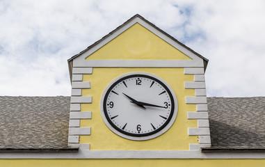 Ten Sixteen on Clock on Yellow Plaster Building