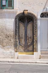 Wooden door. Fasano. Puglia. Italy.