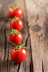 Fresh organic tomatoes on wooden table