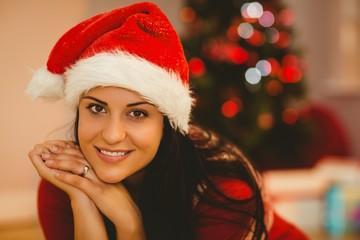 Festive brunette wearing a santa hat
