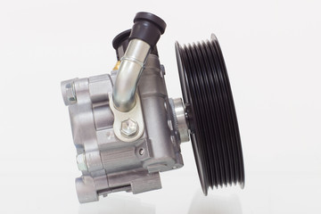 power steering pump on a gray background engine