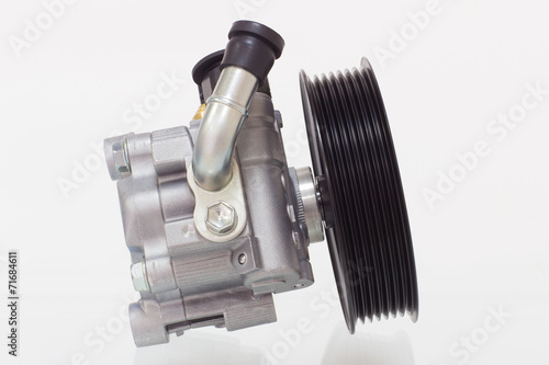 power steering pump on a gray background engine - 71684611