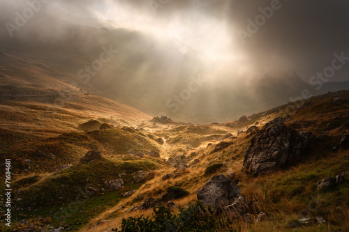 Deurstickers Bergen Dramatic fogy landscape with sunbeams