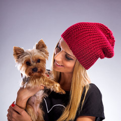 Beautiful woman in  autumn fashion, holding yorkshire terrier