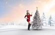 canvas print picture - Composite image of sexy santa girl pointing