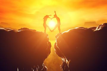 Happy couple in love making heart shape over precipice
