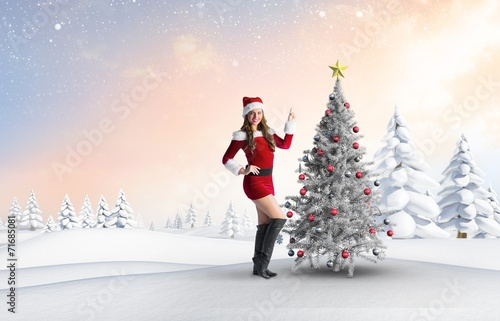 canvas print picture Composite image of sexy santa girl pointing