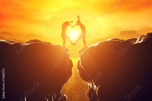 Poster Happy couple in love making heart shape over precipice