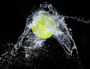 Sport ball with water splash on black background