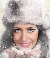 Portrait of beautiful smiling woman, winter theme.