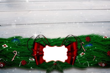 Composite image of fir branch christmas decoration garland