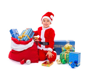 Little Santa Claus boy with presents