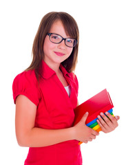 Portrait of smiling schoolgirl holding books