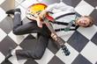 Leinwanddruck Bild - fifties style - young guitarist playing lying on the floor
